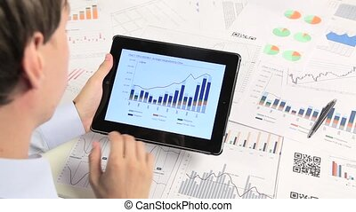Business people developing a business project and analyzing...