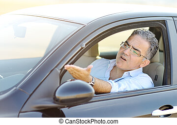 irritated male driving car in traffic - road rage concept