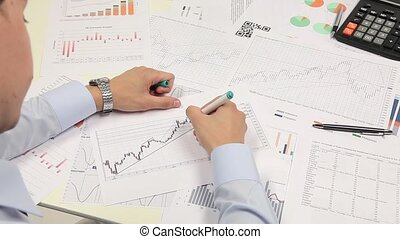 Graph Of Business Budget Business man working with the...