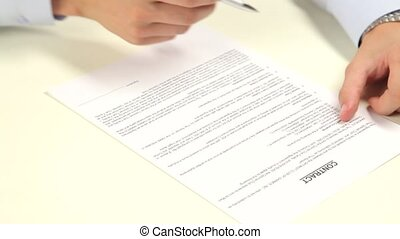 man signing a contract, isolated on white