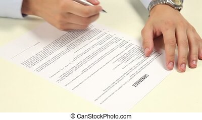 Man not signing a contract - Man signing a contract,...