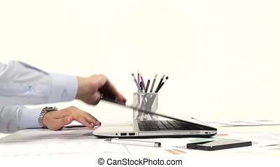 Man hand on laptop keyboard in the office
