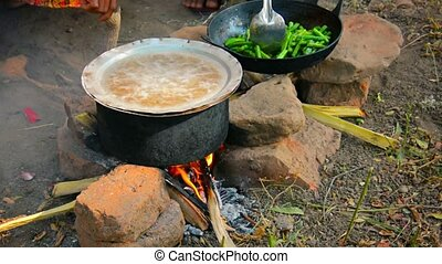 Cooking on a fire in the open air. So feed merchants at the fair. Bagan, Myanmar