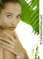 tender - portrait of young beautiful woman on green leafs...