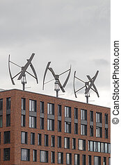 Wind Generators - Wind energy production atop a building in...