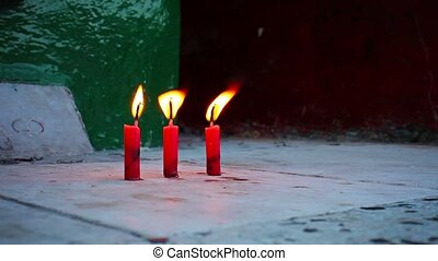 Three candles in Buddhist temple, Burma, Yangon