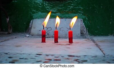 Candles in the old Buddhist monastery in Myanmar, Yangon -...