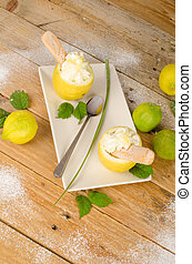 Lemon sorbet - Homemade lemon sorbed served inside an empty...