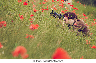 woman photographer taking photo with camera in nature -...