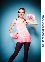 Female boxer wearing big fun pink gloves playing sports -...
