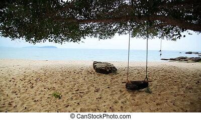 empty swing at beach, sihanoukville, cambodia