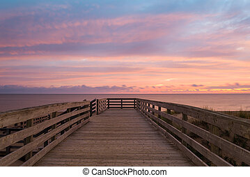Boardwalk on beach at the crack of dawn - Boardwalk on...