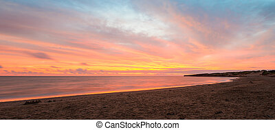 Panorama of beach at the crack of dawn Green Gables Shore,...