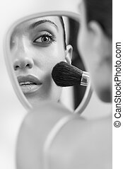 in mirror - Portrait of nice young gorgeous woman in black...
