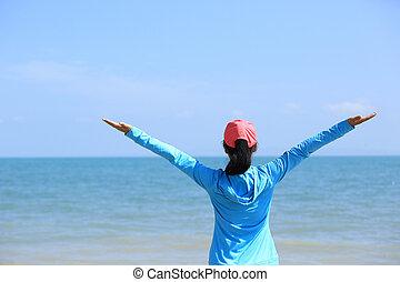 heering woman seaside - heering woman hiker stand seaside...