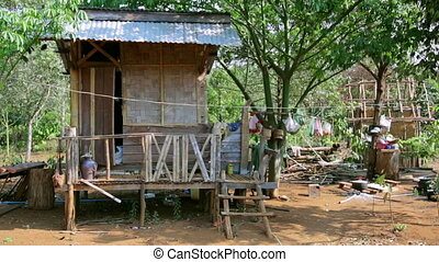 poor lao village houses in rural life, Laos
