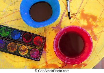 Children messy dirty student watercolor table in vivid...