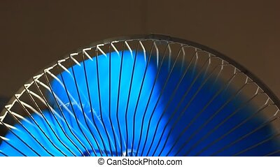 Oscillating fan spinning with rotat
