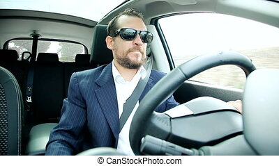 Business man driving car - Happy business man driving...