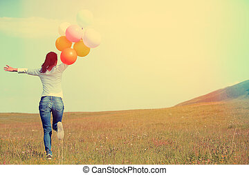 young asian woman with balloons - young asian woman running...