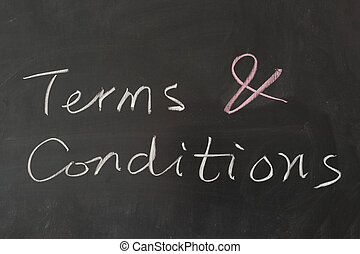 Terms and conditions words on blackboard