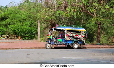 Single tuk tuk on road, Luang Prabang, Laos