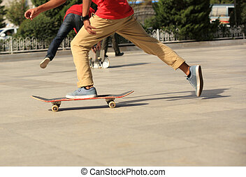 young boys skateboarding in the city