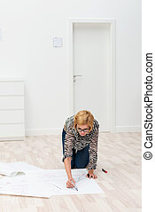Woman sketching a plan in her new house
