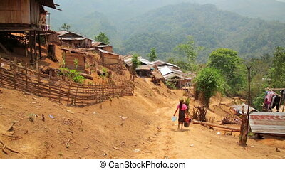 indigenous tribal culture of Akha tribe village, Pongsali,...