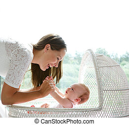 Happy mother and cute baby playing