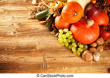 Autumn harvested fruit and vegetable on wood - Autumn...