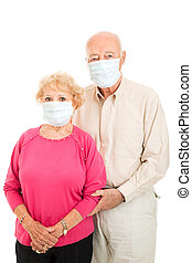 Senior Couple - Flu Protection - Worried senior couple...