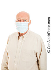 Senior Man - Flu Protection - Senior man wearing a surgical...