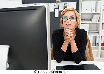 Businesswoman sitting thinking and planning