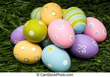 Easter Eggs on Grass - A group of brightly colored easter...