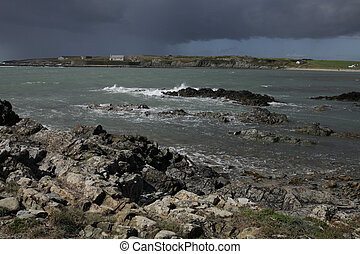 Porth Cwylan bay. - A view from rocks across the sea to an...