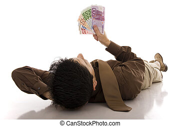 Lying - A sucesseful business man lying on the floor looking...