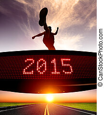 happy new year 2015runner jumping and crossing over matrix...