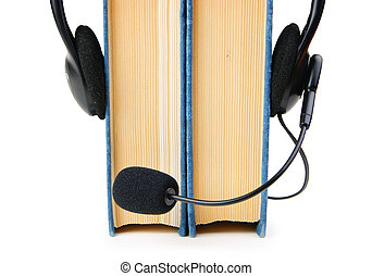 Headphones with a microphone and a stack of books isolated on wh