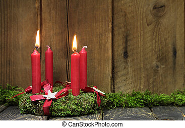 Advent or christmas wreath with four red wax candles -...