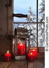 Old wooden windowsill decorated with four red christmas...