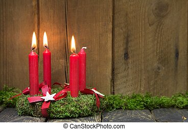 Advent or christmas wreath with four red wax candles. -...