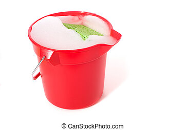 Bucket of Soapy Water - A bucket of soapy water on a white...