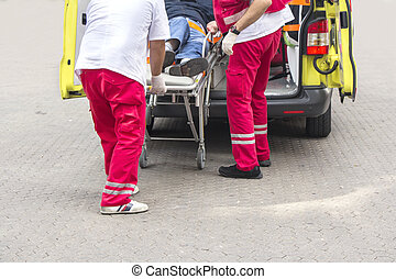 Ambulance  - Paramedics rushing patient into an ambulance