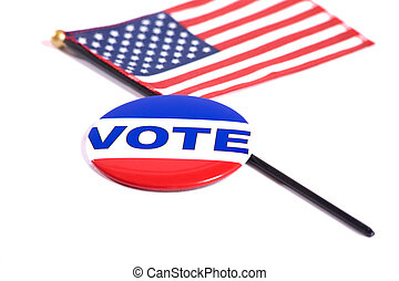 Election Symbols - A VOTE button lying on top of an American...