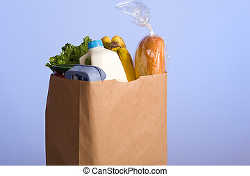 Bag of Groceries on blue - A brown paper bag full of...