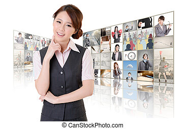 woman standing in front of TV - Attractive Asian business...