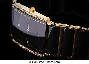 wrist watch - A close up of a mans wrist watch