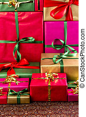 Towering Stack of Gifts - Heap of unicolored presents placed...