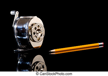 Pencil Sharpener and Pencil - A pencil sharpener and a...